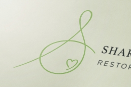 Sharon Kempthorne Logo Close-up
